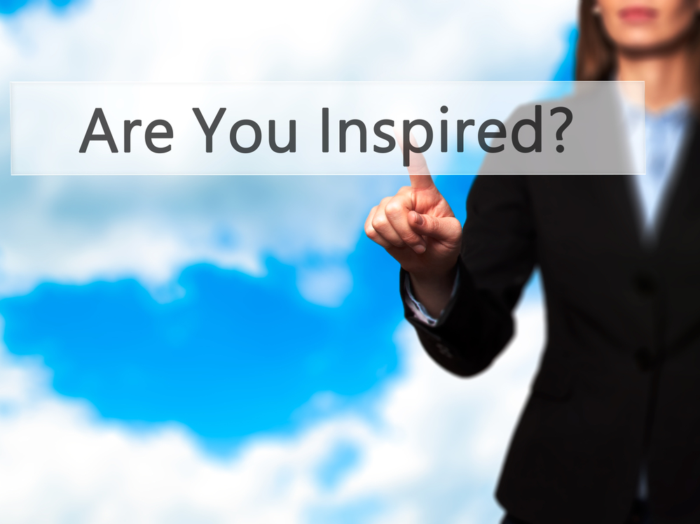 Are You Inspired? - Hand Pointing to Slogan